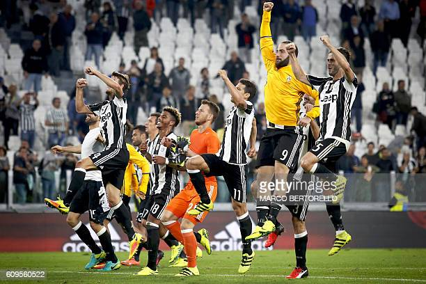 Juventus' players celebrate after the Italian Serie A football match between Juventus and Cagliari on September 21 2016 at Juventus Stadium in Turin...