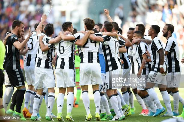 Juventus' players celebrate after winning the Italian Serie A football match Juventus vs Crotone and the 'Scudetto' at the Juventus Stadium in Turin...