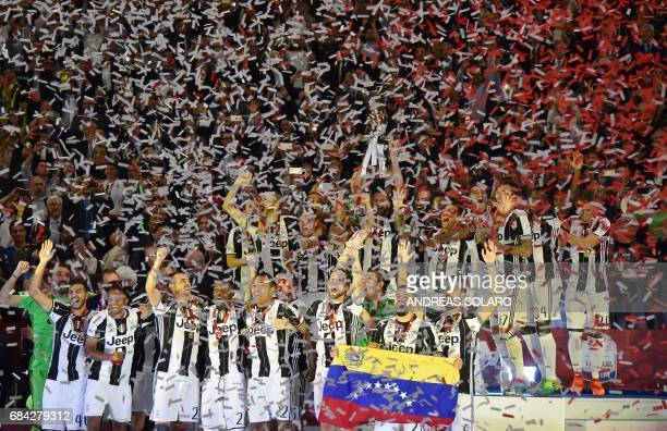 TOPSHOT Juventus' players celebrate after winning the Italian Tim Cup final on May 17 2017 at the Olympic stadium in Rome Dani Alves and Leonardo...
