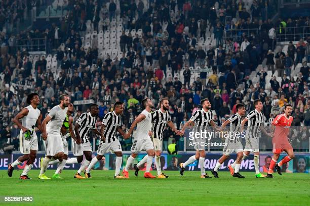Juventus' players celebrate at the end of the UEFA Champions League Group D football match Juventus vs Sporting CP at the Juventus stadium on October...