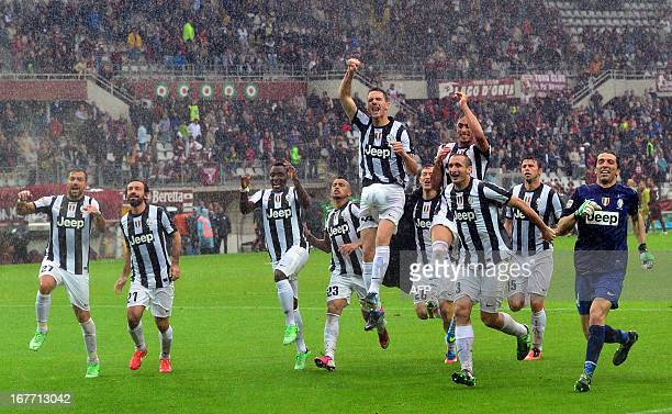 Juventus players celebrate at the end of their Seria A football derby match between Torino and Juventus at the Olympic Stadium in Turin on April 28...