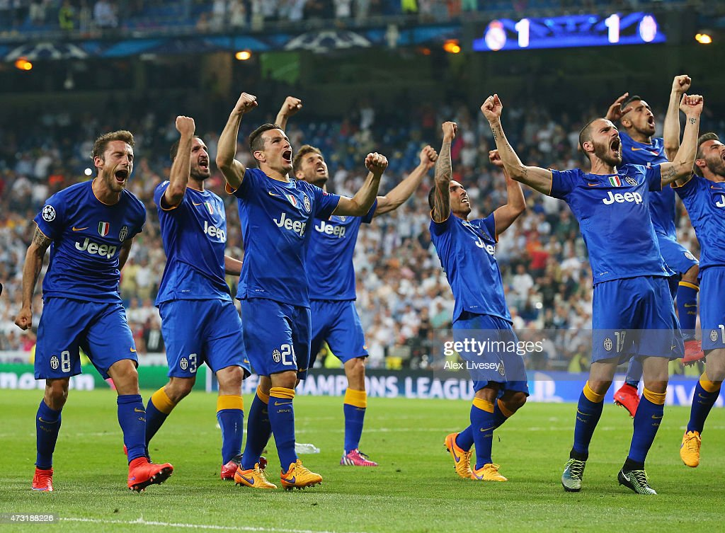 Juventus players celebrate following their progression to the final during the UEFA Champions League Semi Final second leg match between Real Madrid...