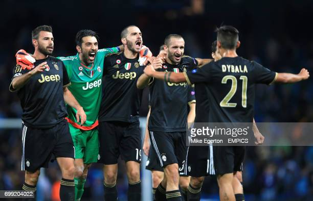 Juventus players celebrate their sides win with goalkeeper Gianluigi Buffon after the final whistle