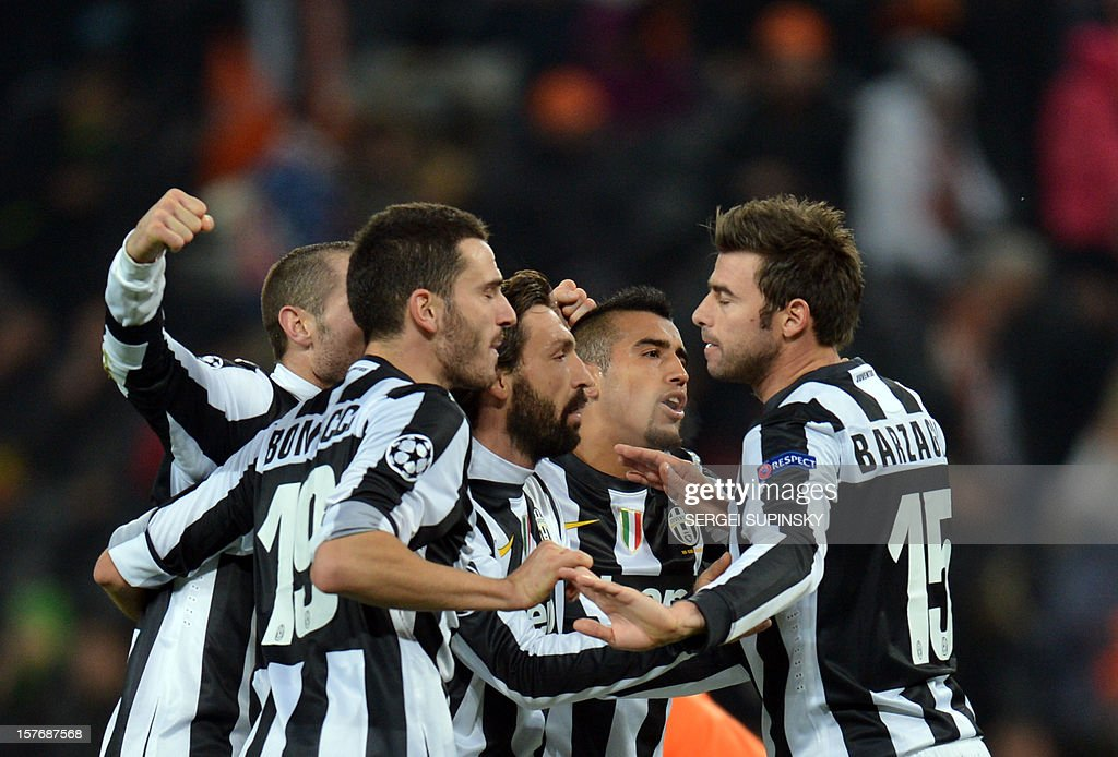 Juventus players celebrate their team's victory at the end of the UEFA Champions League football match FC Shakhtar Donetsk vs Juventus Turin in Donetsk on December 5, 2012. Juventus won 1-0. AFP PHOTO/ SERGEI SUPINSKY