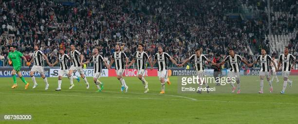 Juventus players celebrate victory at the end of the UEFA Champions League Quarter Final first leg match between Juventus and FC Barcelona at...