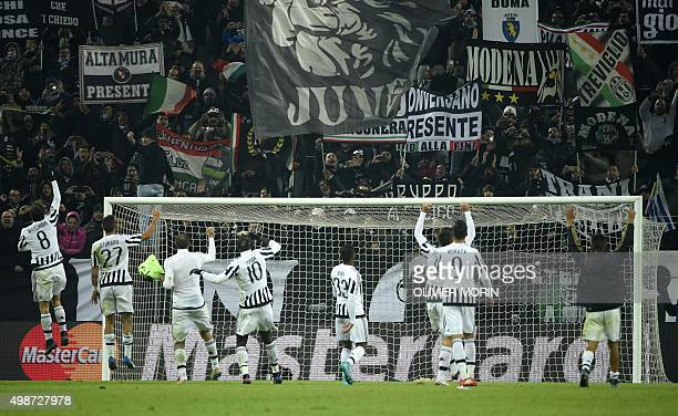 Juventus players celebrate with fans after winning 10 the UEFA Champions League football match Juventus vs Manchester City on November 25 2015 at the...
