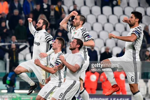 Juventus players celebrate with supporters after winning the UEFA Champions League football match Juventus vs FC Porto on March 14 2017 at the...