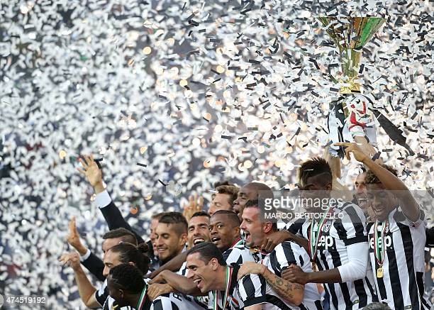 Juventus' players celebrate with the Italian League's trophy during a ceremony following the Italian Serie A football match Juventus vs Napoli on May...