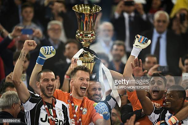 Juventus players celebrate with the trophy after winning the Italian Tim Cup final football match AC Milan vs Juventus on May 21 2016 at the Olympic...