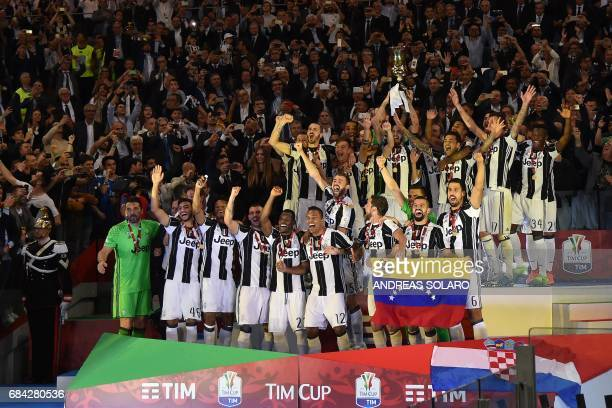 Juventus' players celebrate with the trophy after winning the Italian Tim Cup final on May 17 2017 at the Olympic stadium in Rome Dani Alves and...