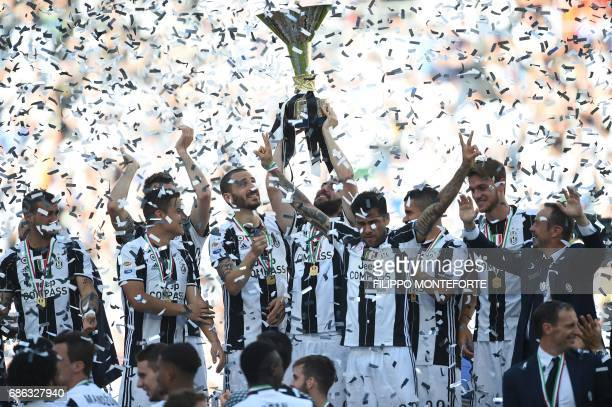 Juventus' players celebrate with the trophy after winning the Italian Serie A football match Juventus vs Crotone and the 'Scudetto' at the Juventus...