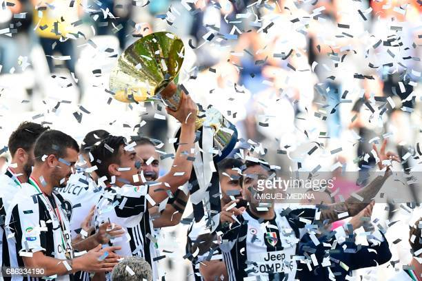 Juventus players celebrate with the trophy after winning the Italian Serie A football match Juventus vs Crotone and the 'Scudetto' at the Juventus...