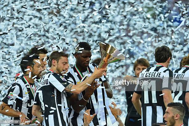 Juventus players celebrate with the trophy during the ceremony of the Scudetto the Italian Serie A trophy after the Italian Serie A football match...