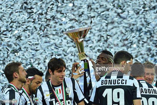 Juventus' players celebrate with the trophy during the ceremony of the Scudetto the Italian Serie A trophy after the Italian Serie A football match...