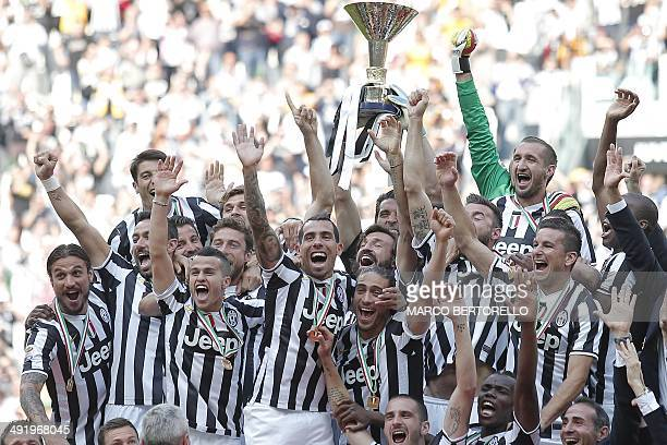 Juventus' players celebrate with the trophy of the Italian Serie A after their last football game of the season Juventus vs Cagliari on May 18 2014...