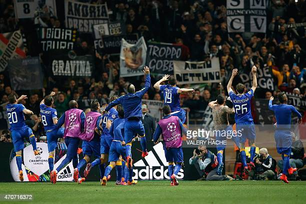 Juventus' players celebrate with their fans after they qualifyed for the semifinals of the UEFA Champions League following the quarter final second...