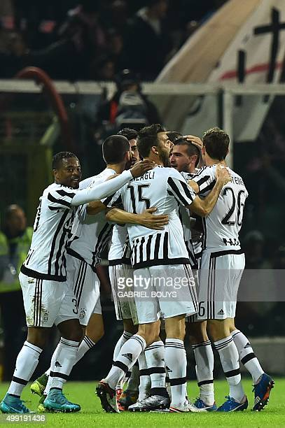 Juventus' players celebrates a goal during the Italian Serie A football match between Palermo and Juventus on November 29 2015 at the Renzo Barbera...
