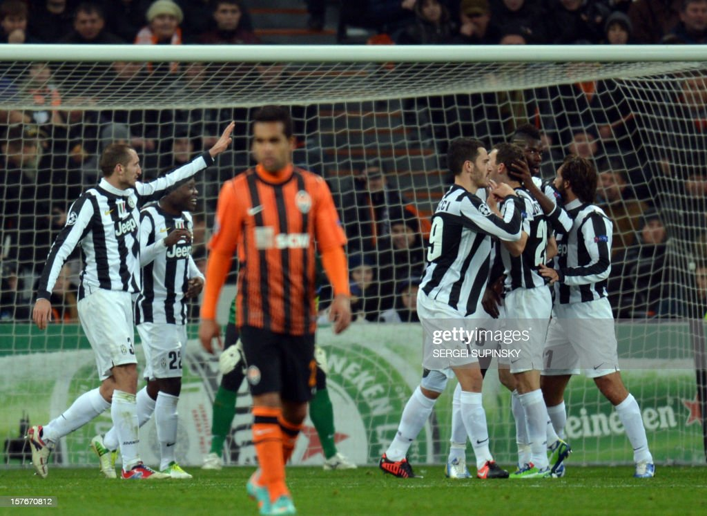 Juventus players celebrates after Shakthar conceded an own goal during the UEFA Champions League football match FC Shakhtar Donetsk vs Juventus Turin on December 5, 2012.