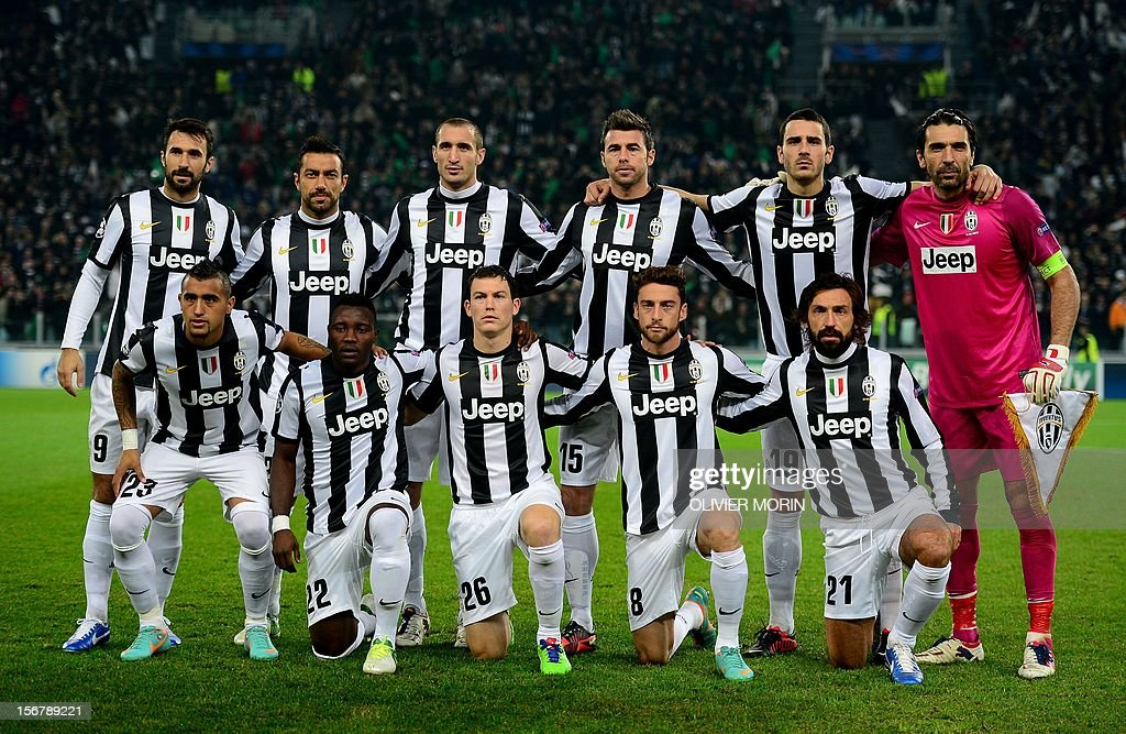Juventus players forward of Montenegro Mirko Vucinic, Juventus' forward Fabio Quagliarella, Juventus' defender Giorgio Chiellini, Juventus' defender Andrea Barzagli, Juventus' defender Leonardo Bonucci and Juventus' goalkeeper Gianluigi Buffon (From L-down) Juventus' midfielder of Chile Arturo Vidal, Juventus' midfielder of Ghana Kwadwo Asamoah, Juventus' Swiss defender Stephan Lichtsteiner, Juventus' midfielder Claudio Marchisio and Juventus' midfielder Andrea Pirlo pose before their Champions League football match between Juventus and Chelsea on November 20, 2012 in stadium of Alps in Turin. AFP PHOTO / OLIVIER MORIN