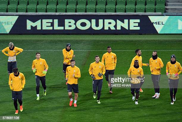 Juventus' players go through their drills during a football training session in Melbourne on July 22 2016 / AFP / SAEED KHAN / IMAGE RESTRICTED TO...