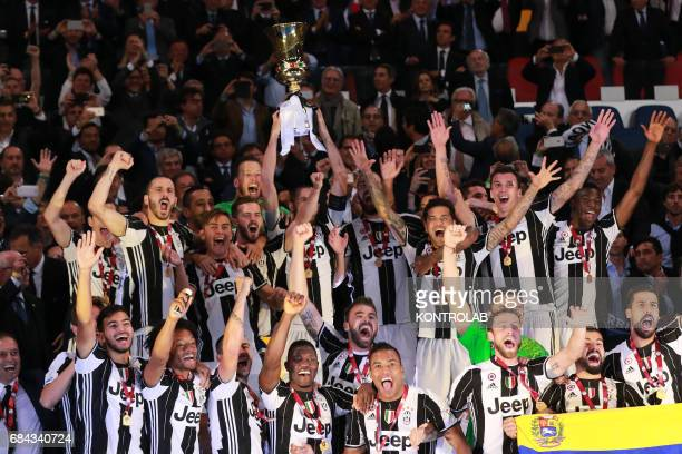 Juventus' players hold the trophy during the TIM Italy Cup Final football match SS Lazio vs Juventus FC at the Olimpico Stadium FC Juventus won the...