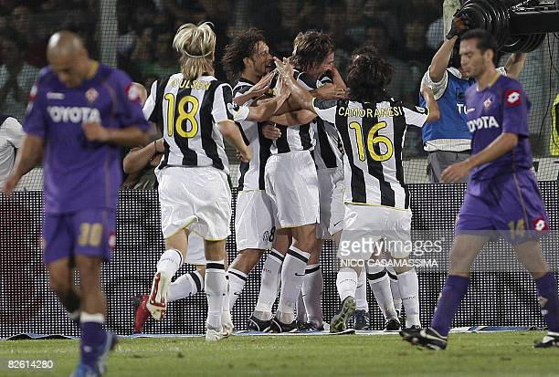 Juventus' players jubilate after unseen Pavel Nedved scoresd against Fiorentina during their Serie A football match at Artemio Franchi stadium in...