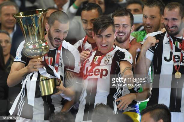 Juventus' players Juventus' defender from Italy Leonardo Bonucci Juventus' defender Medhi Benatia Juventus' forward from Argentina Paulo Dybala...