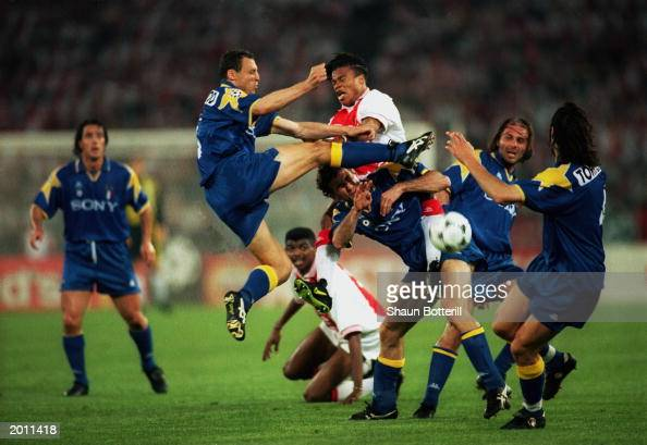 Juventus players Paulo Sousa Pietro Vierchowod Ciro Ferrara Antonio Conte and Moreno Torricelli look to win the ball ahead of Nwankwo Kanu and Edgar...