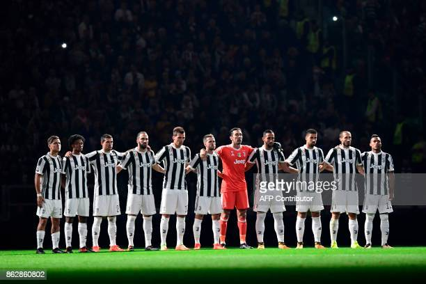 Juventus players pay tribute to the victims of fires in Portugal before the UEFA Champions League Group D football match Juventus vs Sporting CP at...