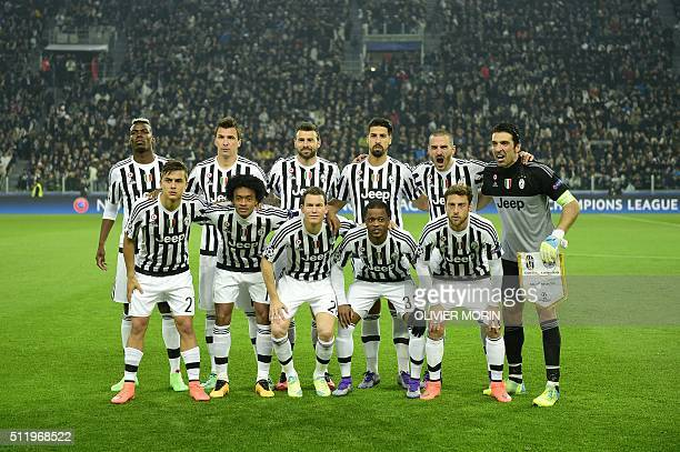 Juventus players pose for a group picture ahead of the UEFA Champions League round of 16 first leg football match between Juventus and Bayern Munich...