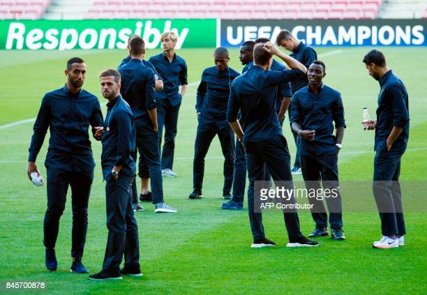 Juventus' players stand on the pitch as they visit the Camp Nou stadium in Barcelona on September 11 2017 on the eve of the UEFA Champions League...