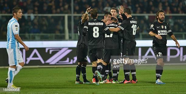 Juventus playes celebrate Juventus' forward Fabio Quagliarella's goal during the Italian Serie A football match between Pescara and Juventus on...