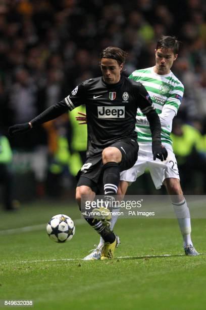 Juventus' Sebastian Giovinco shields the ball from Celtic's Mikael Lustig