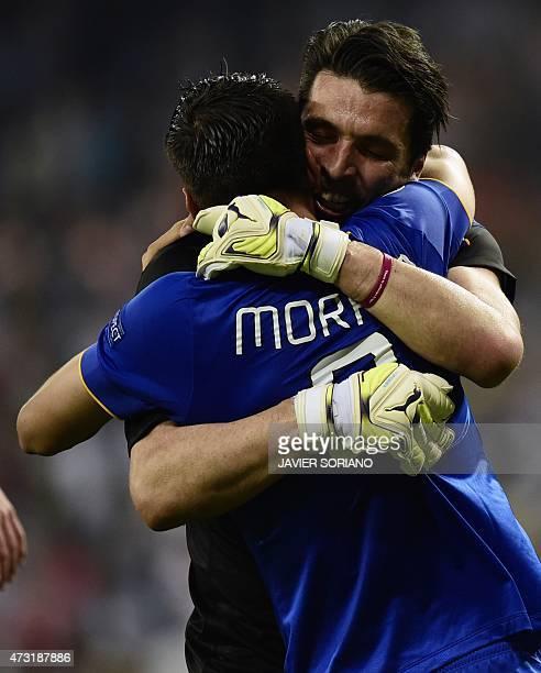 Juventus' Spanish forward Alvaro Morata and Juventus' goalkeeper and captain Gianluigi Buffon celebrate winning the UEFA Champions League semifinal...