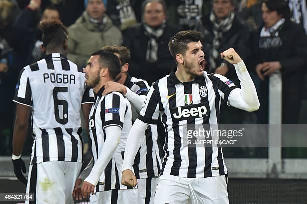 Juventus' Spanish forward Alvaro Morata celebrates after scoring during the UEFA Champions League round of 16 first leg football match Juventus vs...