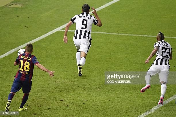 Juventus' Spanish forward Alvaro Morata celebrates after scoring the 11 during the UEFA Champions League Final football match between Juventus and FC...