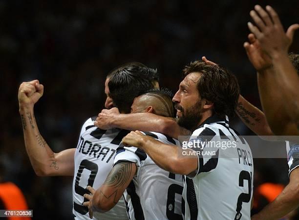 Juventus' Spanish forward Alvaro Morata celebrates with Juventus' midfielder Andrea Pirlo and other teammates after scoring the 11 during the UEFA...