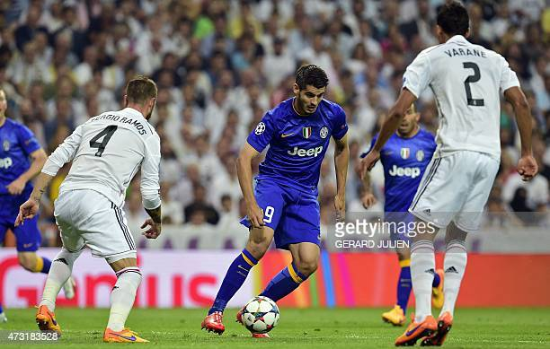 Juventus' Spanish forward Alvaro Morata controls the ball during the UEFA Champions League semifinal second leg football match Real Madrid FC vs...