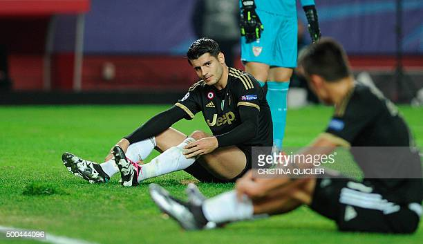 Juventus' Spanish forward Alvaro Morata reacts after missing a goal opportunity during the UEFA Champions League Group D football match Sevilla FC vs...