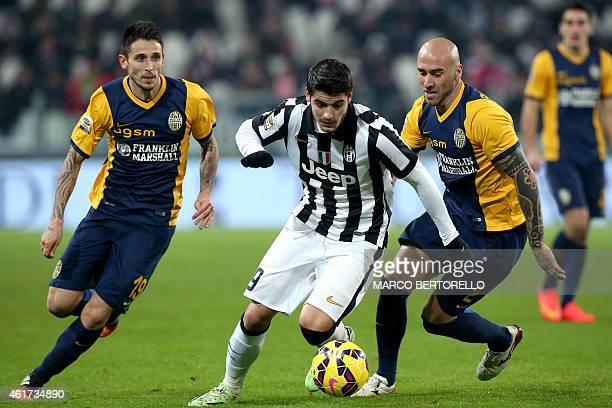 Juventus' Spanish forward Alvaro Morata vies for the ball with Hellas Verona's Uuguayan defender Daniel Guillermo Rodriguez Perez during the Italian...