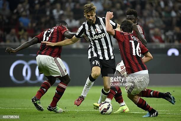 Juventus Spanish foward Fernando Torres Llorente fights for the ball with AC Milan's Colombian defender Cristian Zapata during the Serie A match AC...