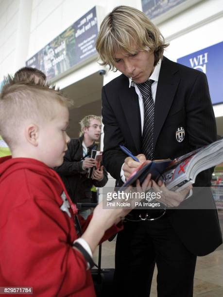 Juventus star Pavel Nedved is met by young fans