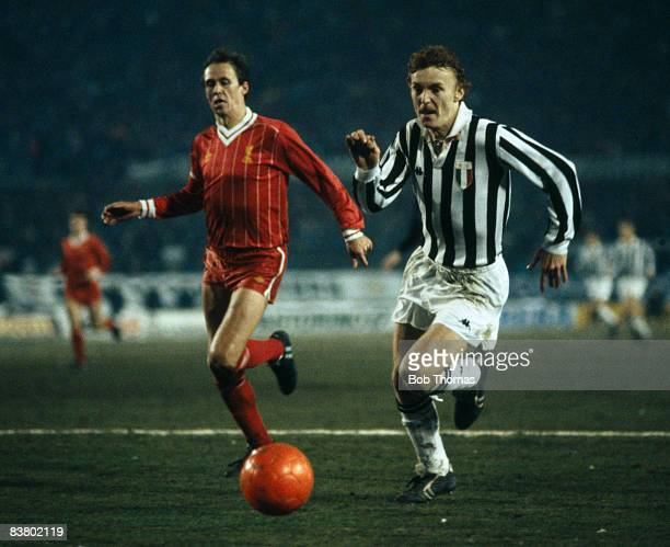 Juventus striker Zbigniew Boniek is chased by Liverpool defender Phil Neal during the UEFA Super Cup Final at the Stadio Comunale in Turin 16th...