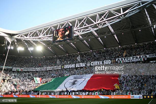 Juventus supporters cheer before the Italian Serie A football match between Juventus and Cagliari at the 'Juventus Stadium' in Turin on May 9 2015...