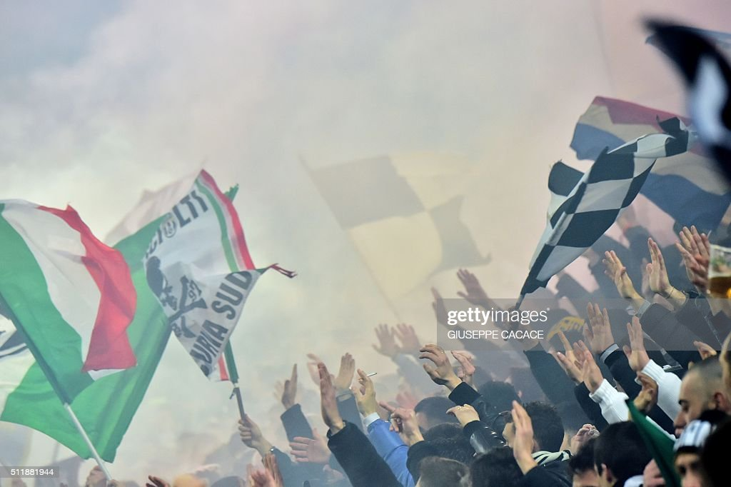 Juventus' supporters cheer for their team ahead of the UEFA Champions League round of 16 first leg football match between Juventus and Bayern Munich...