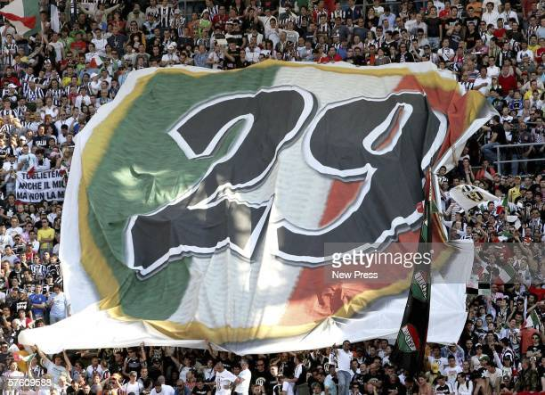 Juventus supporters cheer on their team during the Serie A match between Reggina and Juventus at the Stadio Granillo on May 14 2006 in Bari Italy...
