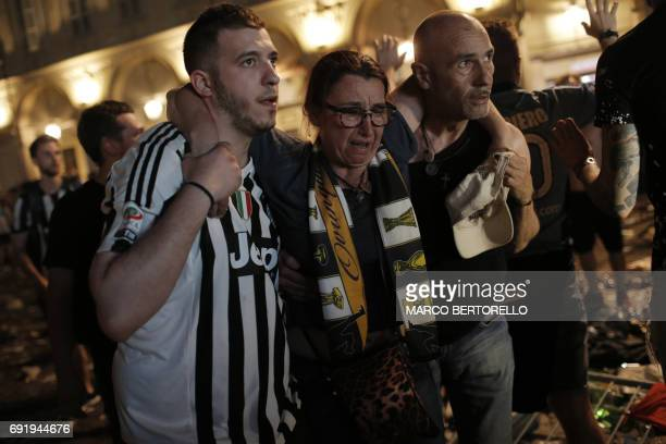 TOPSHOT Juventus' supporters evacuate the Piazza San Carlo after a panic movement in the fanzone where thousands of Juventus fans watched the UEFA...