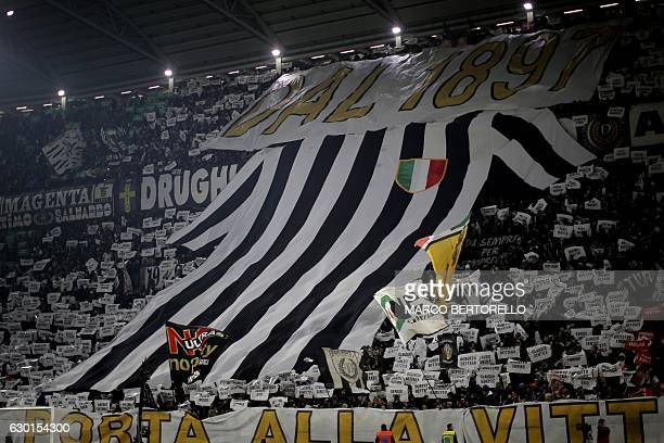 Juventus' supporters hold a giant Juventus jersey during the Italian Serie A football match between Juventus and As Roma on December 17 2016 at the...