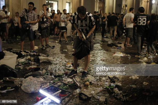 Juventus' supporters look for personal belongings in Piazza San Carlo after a panic movement in the fanzone where thousands of Juventus fans were...