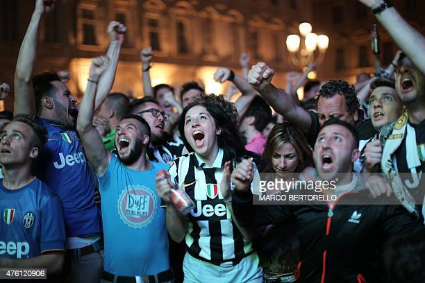 Juventus' supporters react as they watch the UEFA Champions League Final football match between Juventus and FC Barcelona on June 6 2015 in Piazza...